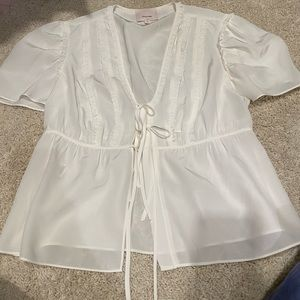 Frilled tie blouse